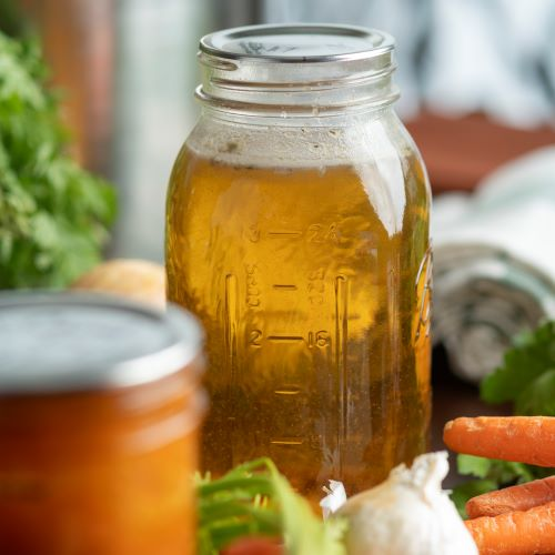 The Canning Diva home canned chicken broth to use in recipes