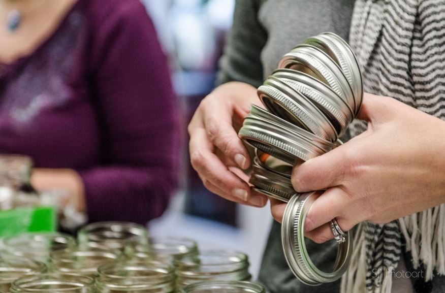 Jars and hands holding rings - canning party with The Canning Diva